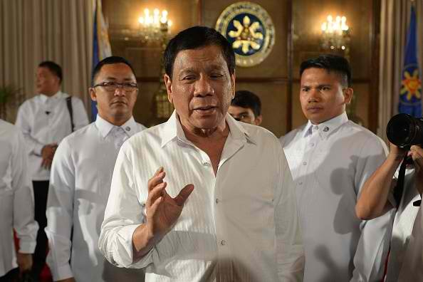 Philippine President Duterte talks to reporters on the issue of the Scarborough Shoal.