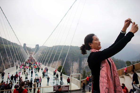 China's 430-Meter-Long Glass Bottom Bridge Opens Again to Tourists