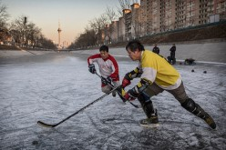 Chinese Men Play Ice Hockey in Beijing