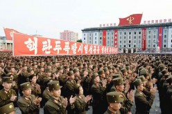 North Korean soldiers praise the successful nuclear arms testing.