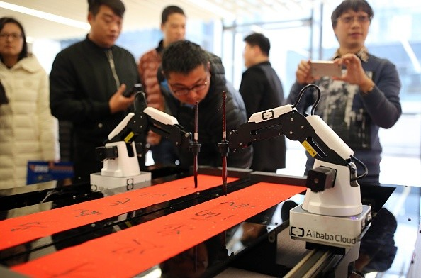 An artificial intelligence robot writes Chinese calligraphy on Jan. 16, 2017 in Hangzhou, Zhejiang Province of China. Hangzhou is one of three recipients of $10 million AI centers from the agreement.