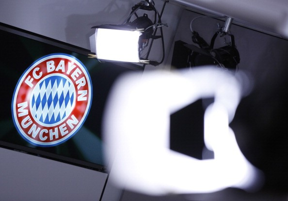 A club logo is seen behind TV lights at the offices of German football club FC Bayern on March 14, 2014 in Munich, Germany.