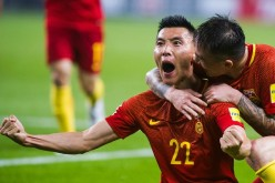 Chinese players celebrate after a major upset against South Korea in the World Cup Qualifiers.
