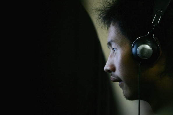 A young Chinese man in front of a computer