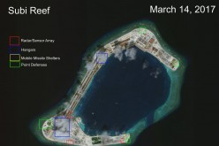 AMTI's satellite photo shows structures built on Subi Reef.