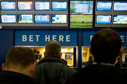 Racegoers in the betting shop area at Sandown Park on February 4, 2017 in Esher, England.