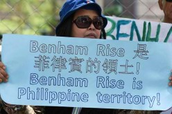 Rallyists in Manila protest over the presence of Chinese research vessels in the Benham Rise.
