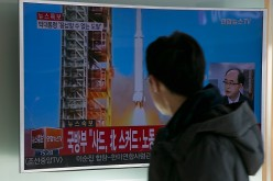 People watch a television screen showing a breaking news on North Korea's long-range rocket launch at Seoul Station on Feb. 7, 2016, in Seoul, South Korea.