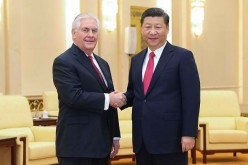 U.S. Secretary of State Rex Tillerson shakes hands with Chinese President Xi Jinping.