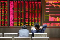 Investors observe stock market movements at an exchange hall on Jan. 6, 2016, in Beijing, China.