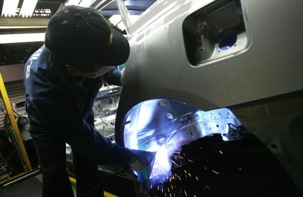 A worker assembles a Hyundai vehicle.