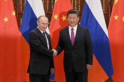China refused an invitation from Russia to form a trilateral alliance with India.