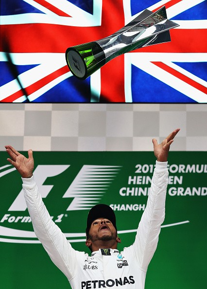 Lewis Hamilton of Mercedes GP celebrates his Grand Prix of China win on the podium.