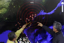 South Korean officials point to the screen to show seismic waves from North Korea at the Korea Meteorological Administration center on Jan. 6, 2016, in Seoul, South Korea.