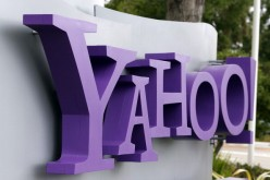 Yahoo is being sued by Chinese dissidents to pay for a fund promised in 2012.