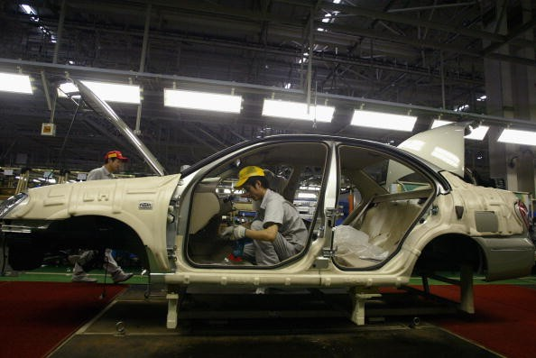 Workers Manufacture Cars at Dongfeng Nissan