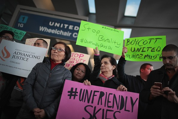 Asians hold protests at the O'Hare Airport Terminal when a Vietnamese doctor was dragged off a United Airlines flight.