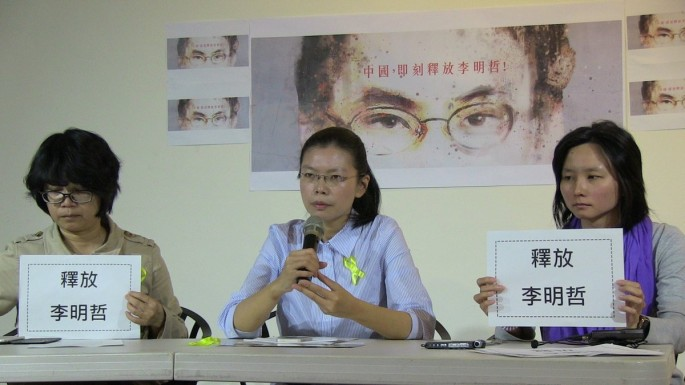 "Zhang said he was inspired to seek asylum in Taiwan by the campaign of Lee Ching-yu (pictured, center) to ""rescue"" her NGO husband, activist Lee Ming-cheh."