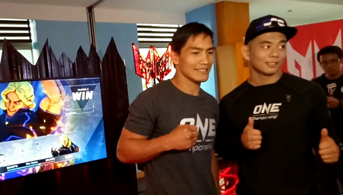 "Asian MMA fighters Eduard ""Landslide"" Folayang and Ev ""E.T."" Ting face off in front of the media at the Top of the Citi Restaurant in Citibank Tower on March 28, 2017 in Manila, Philippines."