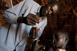 A girl gets tested for malaria at a medical clinic at the Yida refugee camp along the border with North Sudan, July 5, 2012, in Yida, South Sudan.