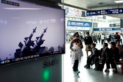 A television report about North Korea's missile launch is broadcast at the Seoul Railway Station on April 1, 2016 in Seoul, South Korea.