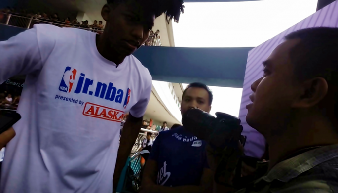 Conan Altatis interviews Orlando Magic's Elfrid Payton at the Music Hall of SMA Mall of Asia in Pasay City, Philippines, at the culminating activity of Jr. NBA Philippines' National Training Camp on May 14, 2017.