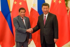 Chinese President Xi Jinping (R) shakes hands with Philippines President Rodrigo Duterte (L) prior to their bilateral meeting during the Belt and Road Forum for International Cooperation.