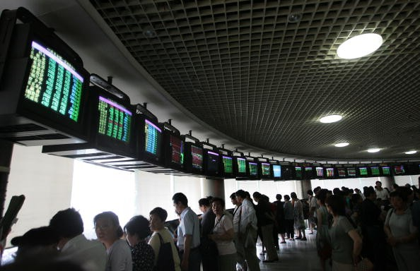 Investors gather to view the stock index at a securities company on May 30, 2007 in Nanjing, China.