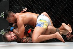 Brad Robinson (bottom) of United States of America fights Agilan Thani of Malaysia in the catchweight bout at 'One Championship: Ascent to Power' at Singapore Indoor Stadium in Singapore on May 6, 2016.