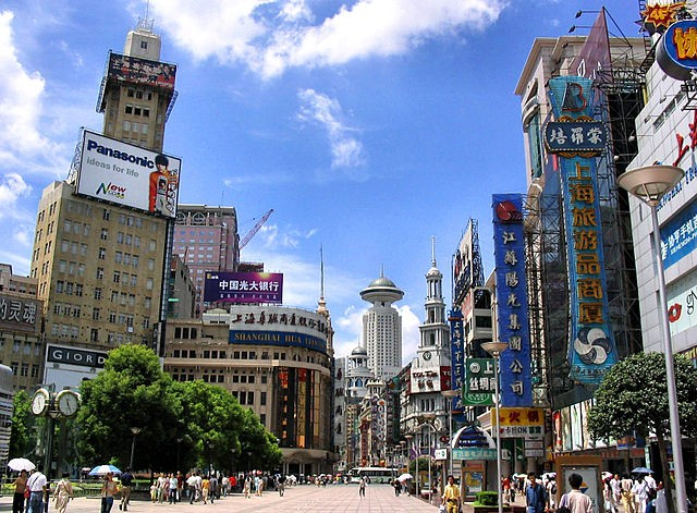 Nanjing Road flanked by buildings and establishments that signify China's performing economy.