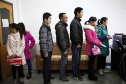 Jobseekers in China queue up for an interview.