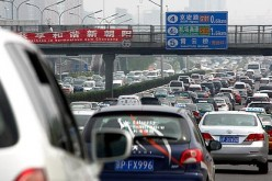 A traffic jam in China, where the population loves cars.