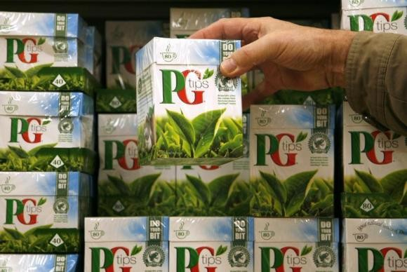 A shopper picks up a box of PG Tips tea bag made by Unilever.