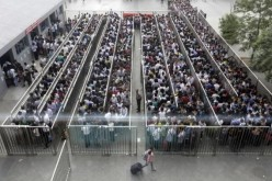 Beijing subway lines can be long during the rush hour.