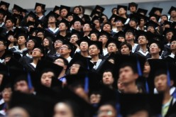 Students attend a graduation ceremony in Shanghai's Fudan University.