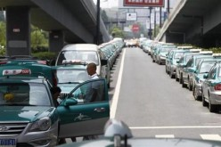 Striking taxi drivers under a bridge in the suburbs of Hangzhou.