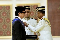 Malaysia's Head of State confers Jackie Chan as