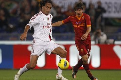 Alessandro Nesta (L) playing for AC Milan in their match against AS Roma.