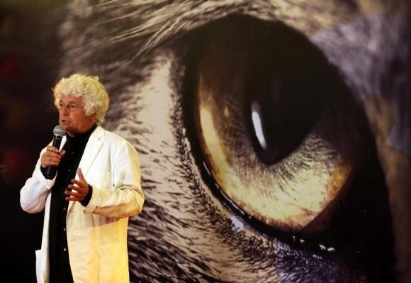 French movie director Jean-Jacques Annaud speaks at a conference.