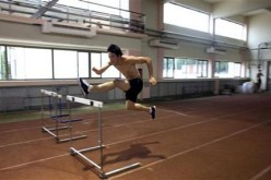China's Liu Xiang clears a hurdle at a training base in Shanghai, June 30, 2009.