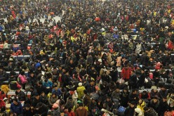 Passengers at Hankou Railway Station in Wuhan during Spring Festival.