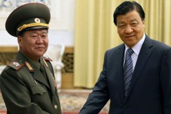 Liu Yunshan (right), a senior Chinese Communist party official, poses for the cameras.