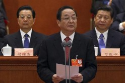 Yu Zhengsheng (C) speaks before the Central Committee of the Communist Party.