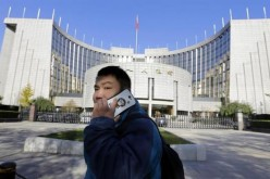 A man uses his mobile phone outside PBOC headquarters.
