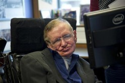 English physicist Stephen Hawking sits at his desk in the Applied Mathematics Department of Cambridge University, Aug. 30, 2012.