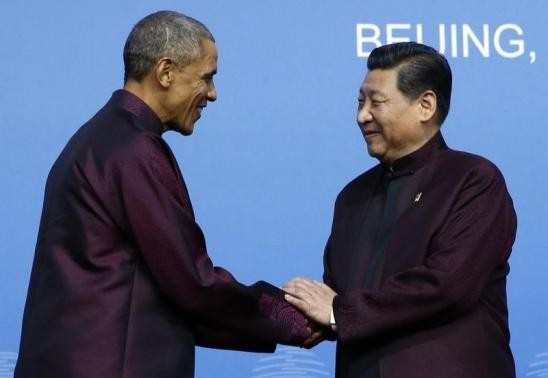U.S. President Barack Obama (L) shakes hands with Chinese President Xi Jinping.