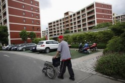 A man walks at the Cherish-Yearn care center facility in Shanghai.