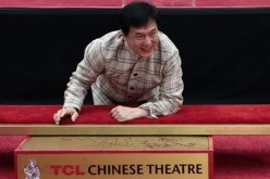 Actor Jackie Chan poses during a hand and footprint ceremony at the TCL Chinese Theatre.