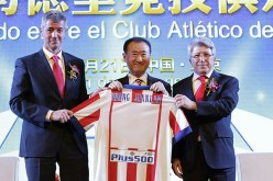 Wang Jianlin, owner of the Wanda Group, as he receives a jersey from Atletico Madrid officials.