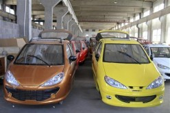 Bodies of electric cars are arranged inside a factory in Weihai, Shandong Province.